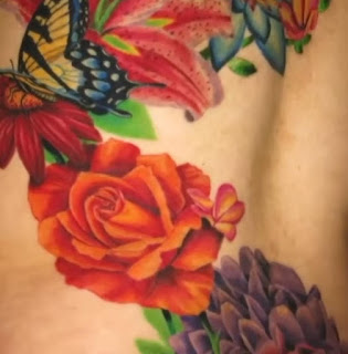 what is cardi tattoo on leg
