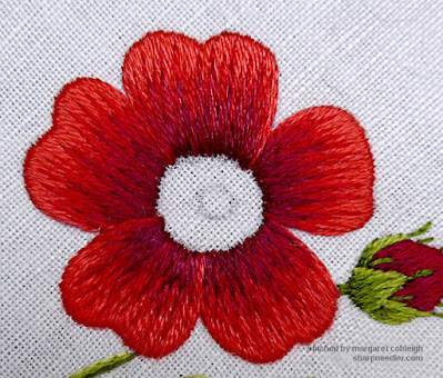 Completed foreground petal on needlepainted rose.