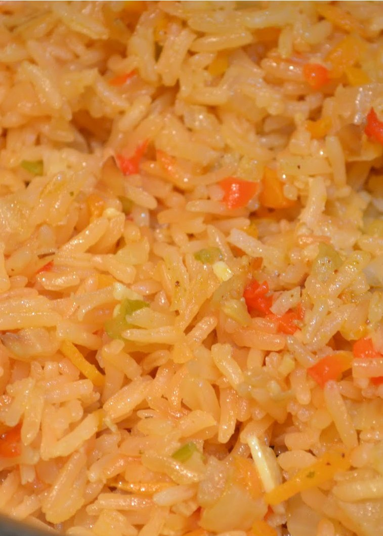 Mexican Rice Fluffed with a fork from Serena Bakes Simply From Scratch.