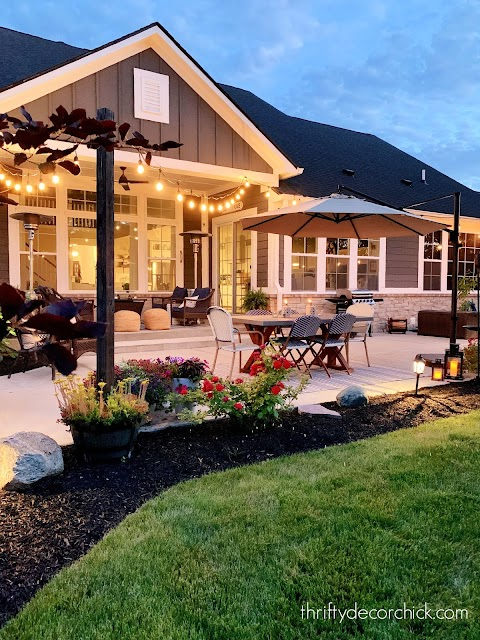 string lights in planters over patio