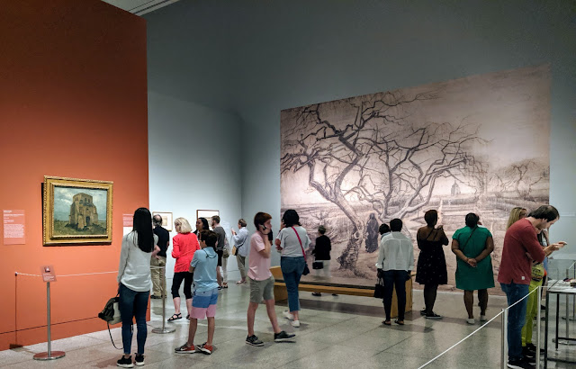 Enlarged sketches by Vincent van Gogh cover many walls and highlight his creative journey