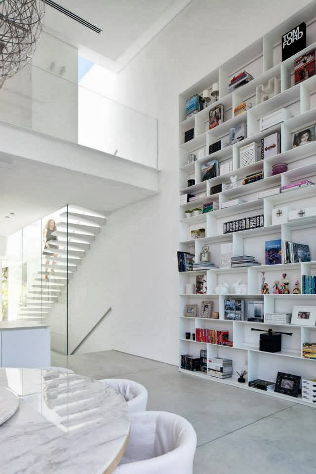 Book shelf in White Ramat Hasharon House by Pitsou Kedem Architects