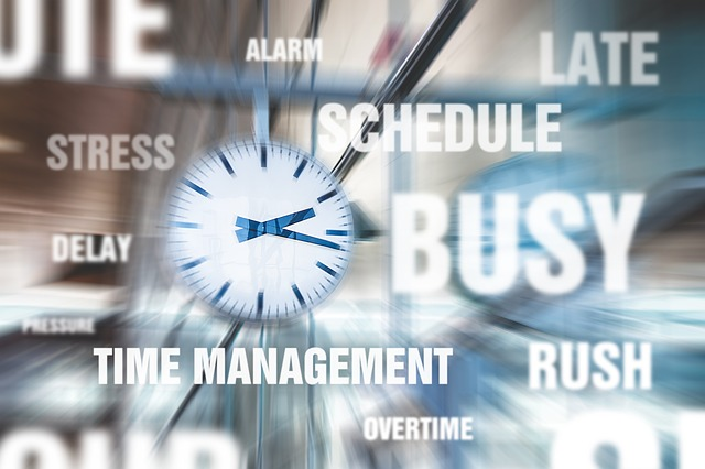 station clock with blurred affect and a variety of words, including: stress, schedule, busy, late, delay, time management, overtime, and rush