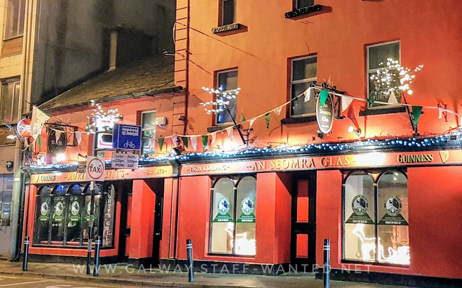 Bright red pub, extending over two or more buildings in central Galway city:   Tigh Cormac - An Seomra Glas ie The Green Room