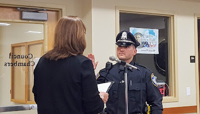 Franklin Town Clerk Teresa Burr swears in new police office Nick Palmieri