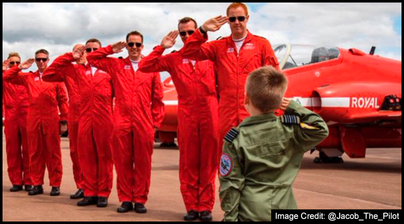 five-year-old @Jacob_The_Pilot receives a salute from the one and only Red Arrows