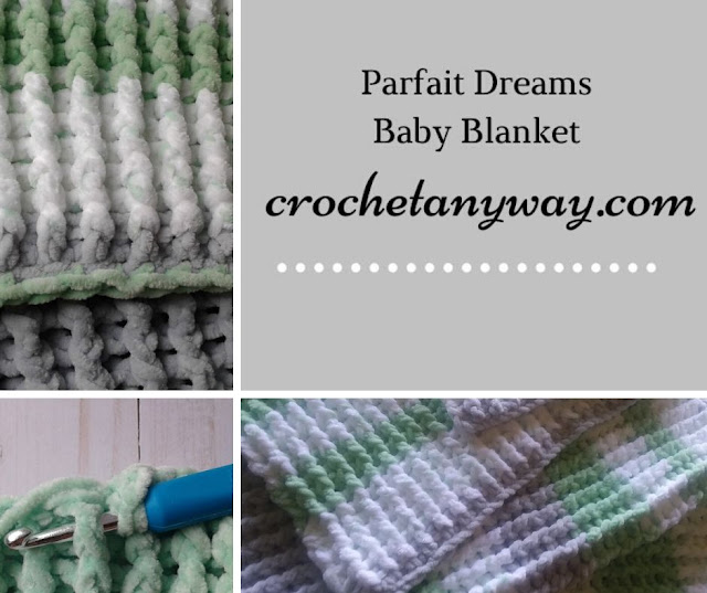 a green and white and grey baby blanket crocheted
