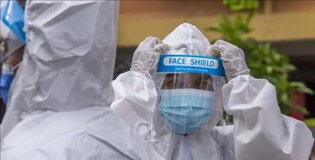 Employees in protective suits work to disinfect at the outskirts of Kuala Lumpur, Malaysia. Photo: THX