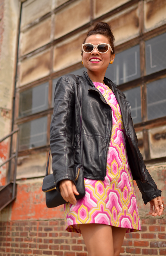 Outfit with printed dress and biker jacket