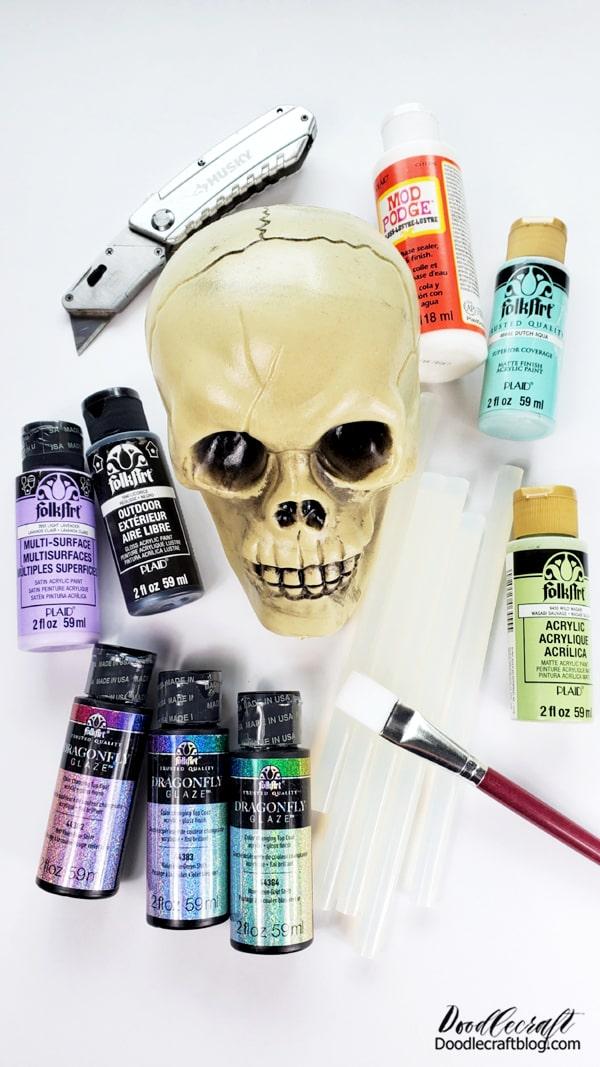 Supplies Needed for the Iridescent Skull: Plastic Skull Black Outdoor FolkArt Paint FolkArt Dragonfly Glaze Paint (at least 3 varieties) Paint Brushes