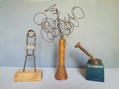 Art piece composed by three small and cute sculptures. The elements used are such us natural rope, old steel pieces found in the coutry side and farmers lands, and wood. also the wood has been painted using acrylic paint.