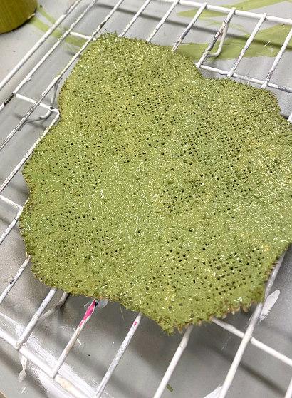 Green painted burlap leaf