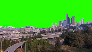 A free video of Seattle buildings, freeway and stadium set against a green screen background.