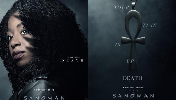 Imagem: a Morte, interpretada por Kirby Howell-Baptiste, uma mulher negra com longos cabelos pretos e um casaco de couro preto e ao lado o seu símbolo do poder um ankh, um símbolo egípcio preto com um formato parecido com uma cruz, mas com uma volta em cima.