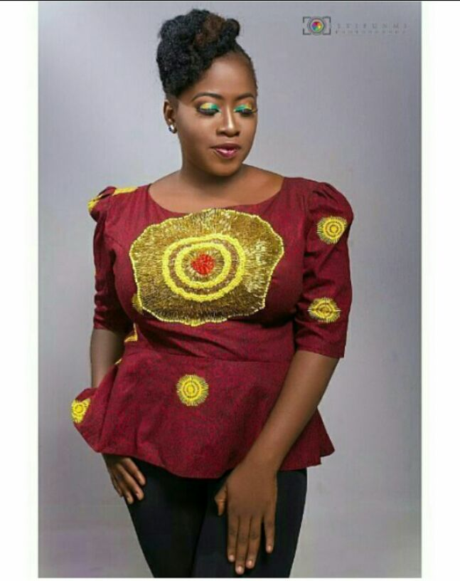 wine coloured ankara top with jeans