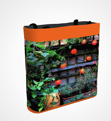 "This screen-shot features an orange tote/bag/pouch which has an image imprinted on it. The picture was taken in my garden when decorated for Halloween. It shows Jack—O-Lantern themed outdoor lights hanging on a wooden trellis. The tote/bag/pouch is available in three sizes (13"" by 13"", 16"" by 16"" and 18"" by 18"") and can be purchased via Fine Art America @ https://fineartamerica.com/featured/jackolanterns-sunbathing-patricia-youngquist.html?product=tote-bag"
