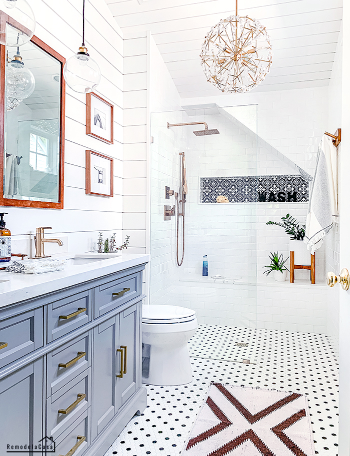 shiplap on ceiling = bathroom with subway tile, shiplap and black and white tile on floor