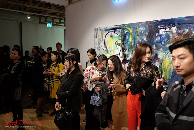 Art lovers listening to the opening night speeches - Beyond the Light - Chinese Artist He Zige - Photos By Kent Johnson for Street Fashion Sydney.