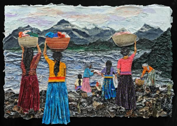 textural paper collage of woman carring baskets of laundry to water's edge with more women already washing laundry