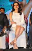 Beautiful Smiling Kajal Aggarwal in Creamy White Gown at MLA Telugu Movie Success Meet ~ .com Exclusive Pics 018.jpg