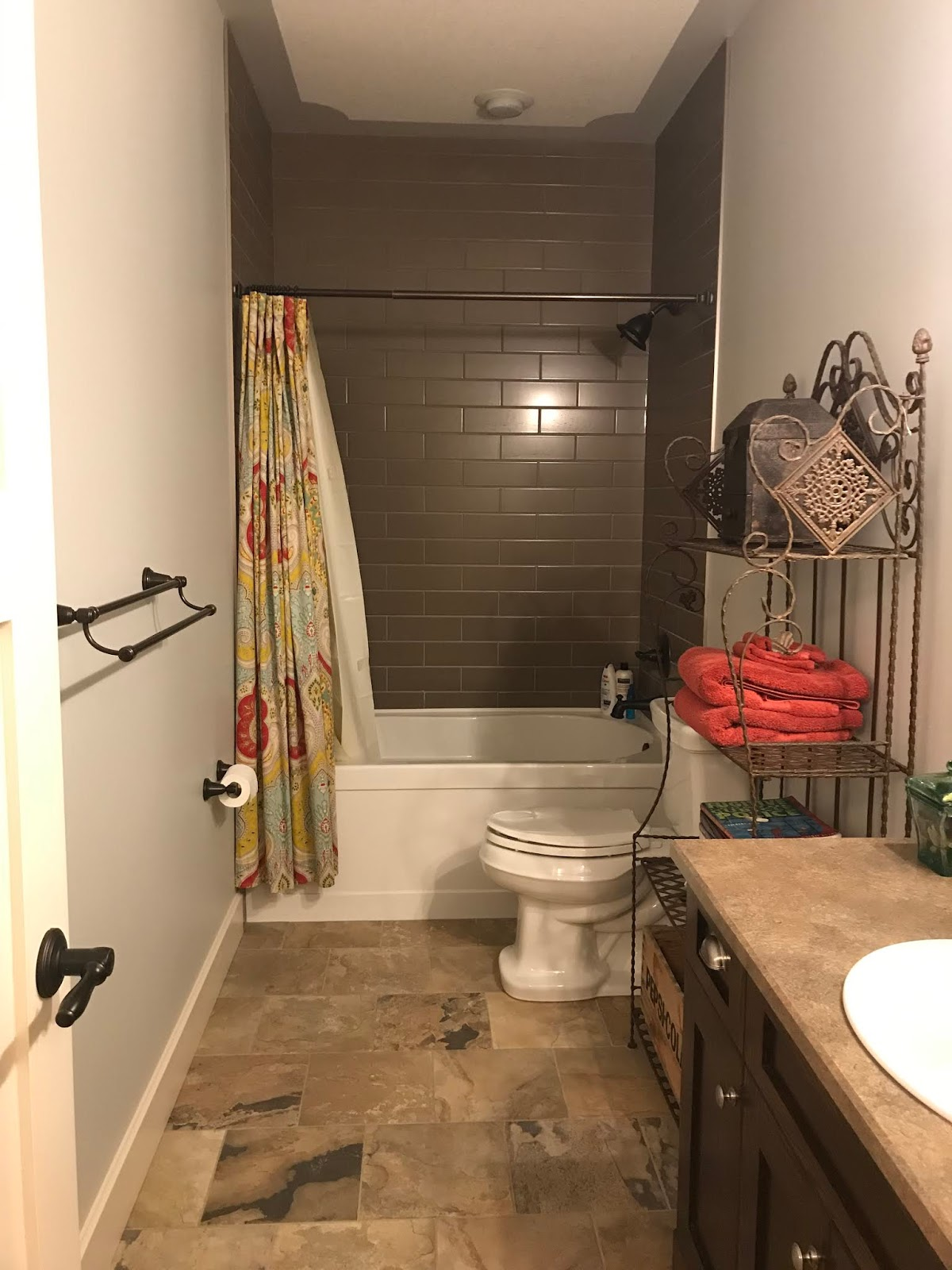 Short shower curtain makes bathroom feel smaller