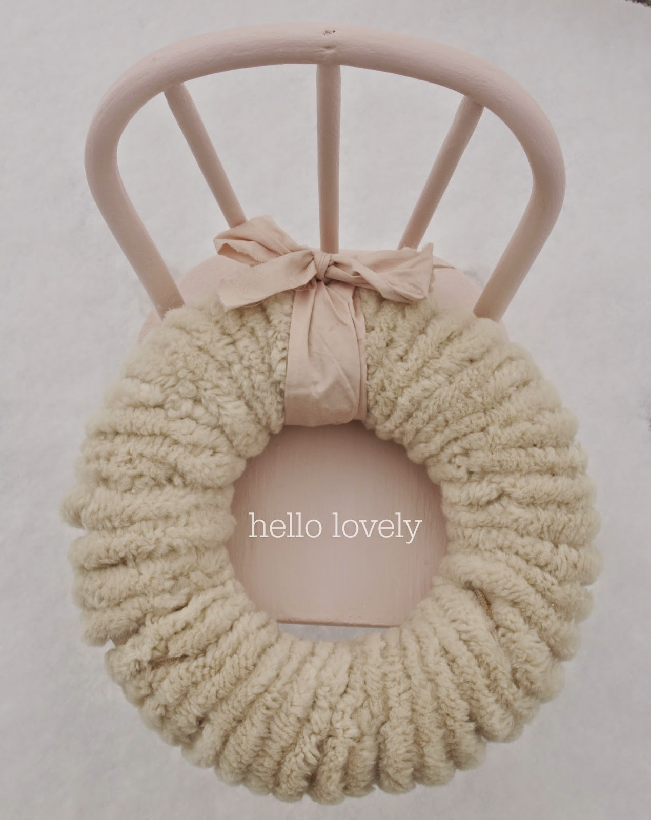 hello-lovely-studio-wolly-pom-pom-wreath-pink-ribbon-chair-snow