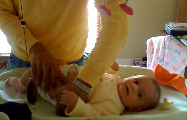 Image: Aman teaching me Diaper 101, by Sanjoy Ghosh on Flickr