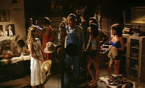 Slausen (Chuck Connors) gives a tour of his museum, Tourist Trap (1979)