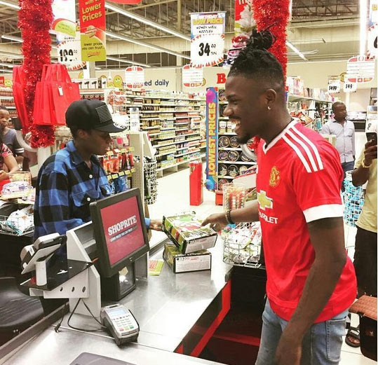 Ycee becomes cashier/attendant at Shoprite, Lagos