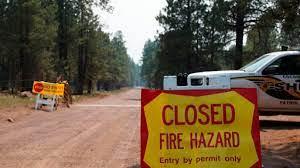 Wildfires burn across US West