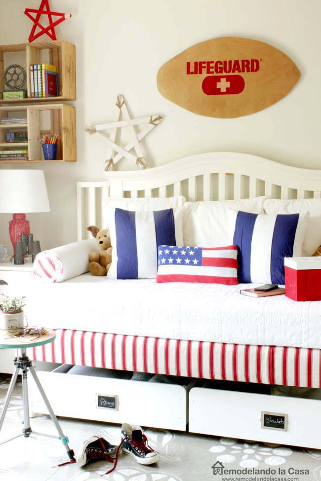 red white and blue guest bedroom with skim board sign - lifeguard