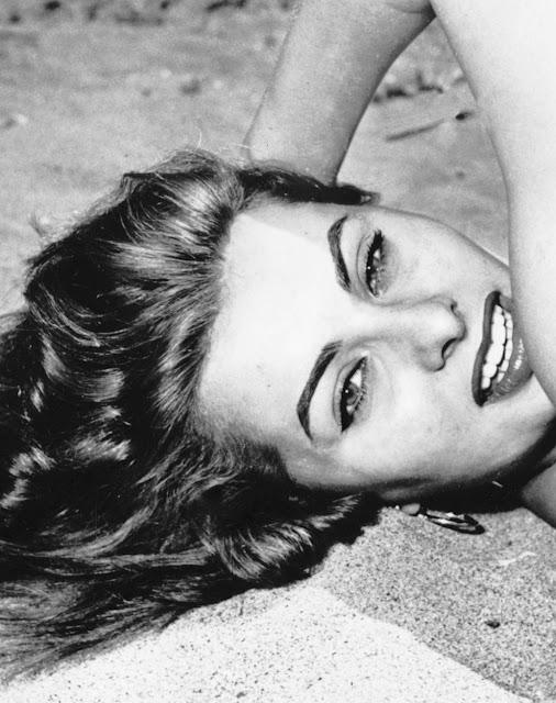 1954. Sophia Loren relaxes on a beach in Italy, June 1954