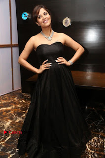 Telugu Anchor Actress Anasuya Bharadwa Stills in Strap Less Black Long Dress at Winner Pre Release Function  0047.jpg