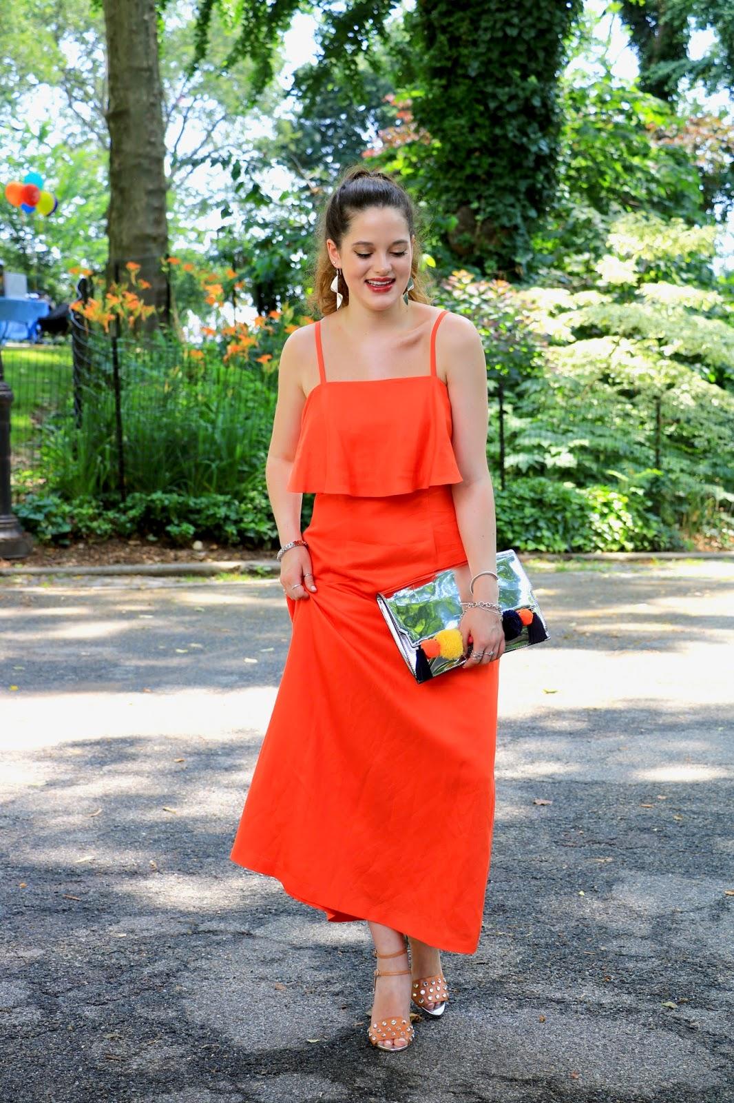 Fashion blogger Kathleen Harper of Kat's Fashion Fix wearing an orange maxi dress
