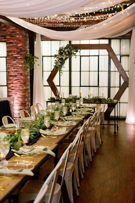 long reception table and arch