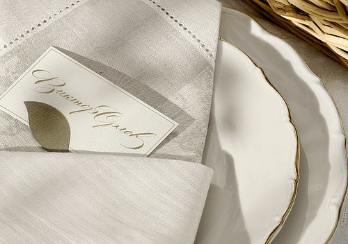 photo of white napkin with place card in it for dinner party