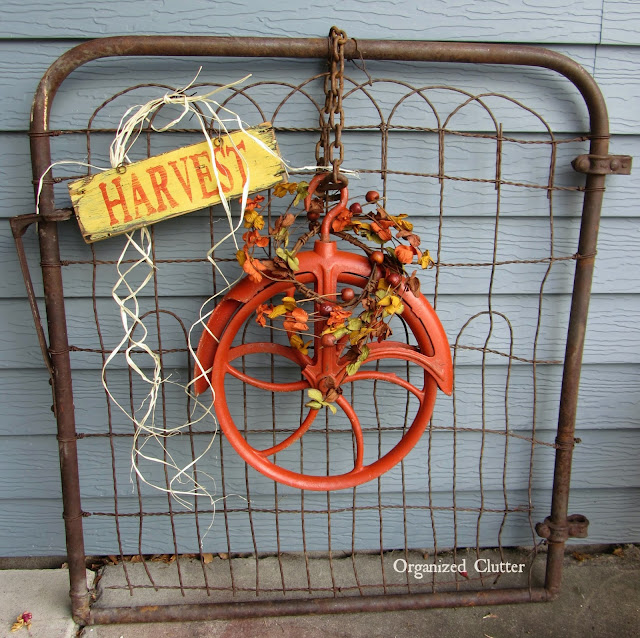 Photo of a pulley wreath hanging on a gate.