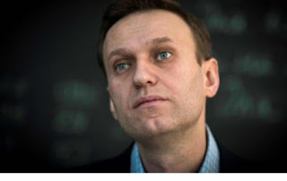Alexey Navalny unconscious and hospitalized after falling ill from suspected poisoning, his spokeswoman announced