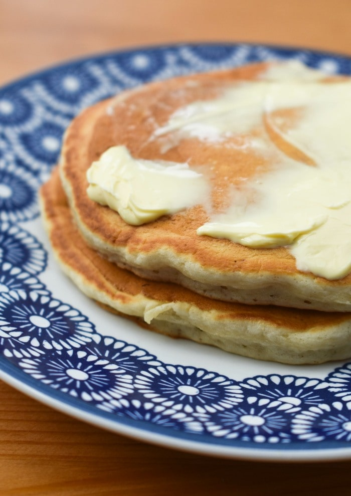 A small stack of vegan scotch pancakes spread with vegan butter