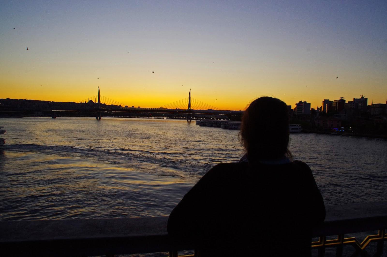 Girl watching Istanbul sunset over Bosphorus
