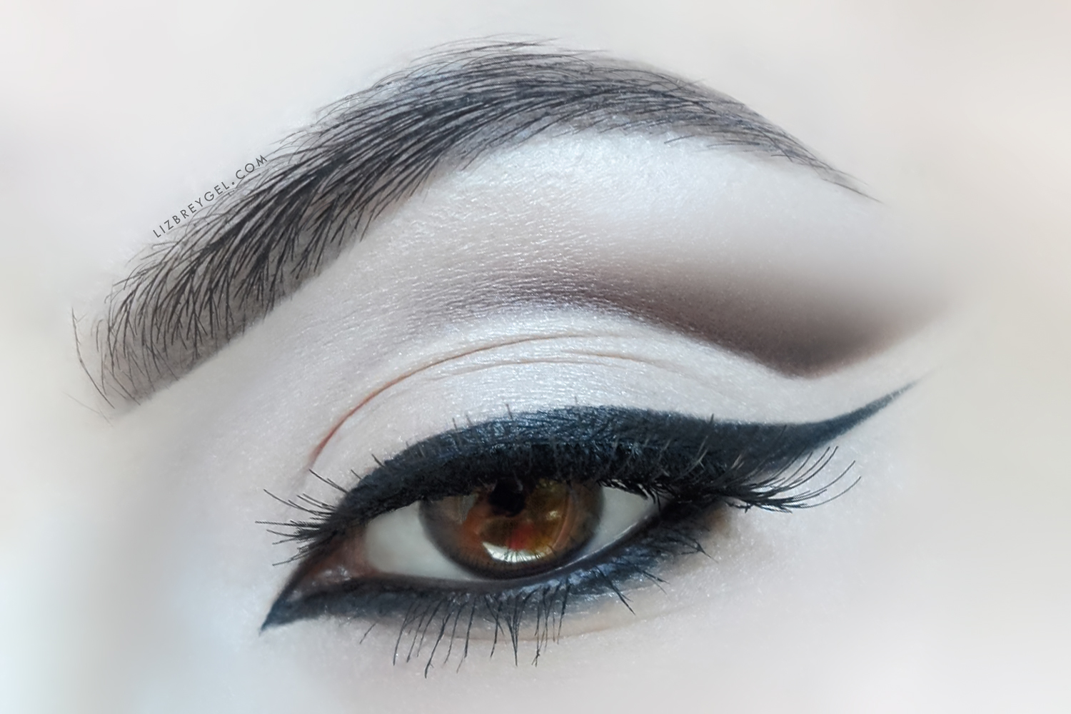 a close up image of n eye with an elegant bridal makeup look
