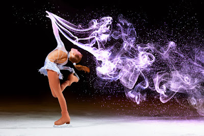 Pic of girl skating beautifully on ice with dramatic smoke trails