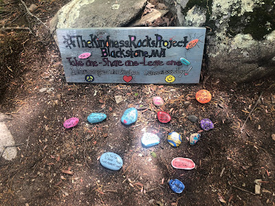 """Painted sign saying, """"#TheKindnessRockProject Blackstone, MA Take one - Share one- Leave one 1 message can change someone's day"""""""