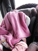 photo of sleeping child covered by blanket in car trip | road trip with toddlers
