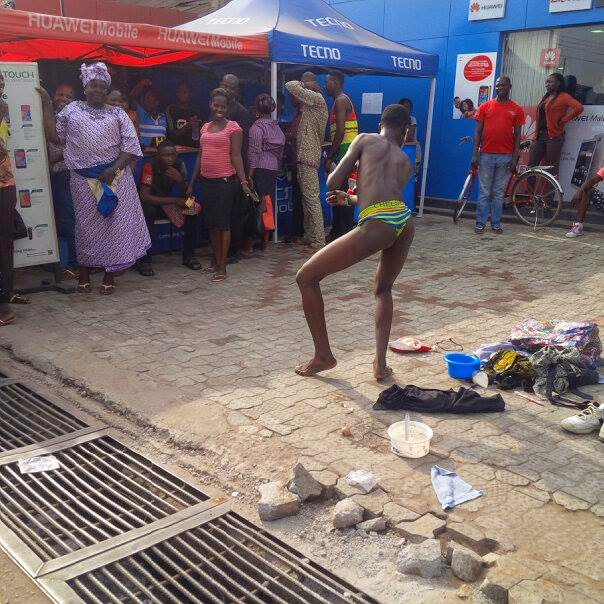 Hunger Turns Nigerian Youth into Street Comedian, Strips Naked to Amuse Crowd (Photos)