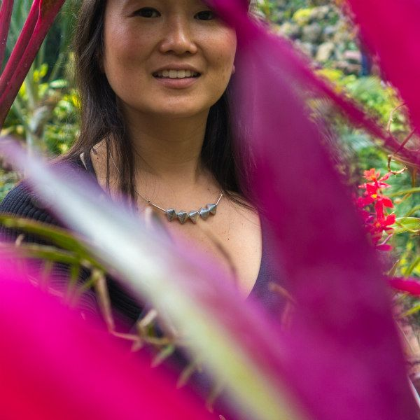 model wears a five-bead origami paper necklace