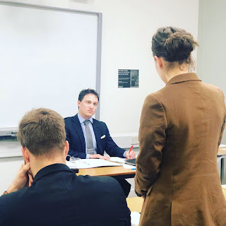A photo of Elijah Granet listening to submissions during the moot.