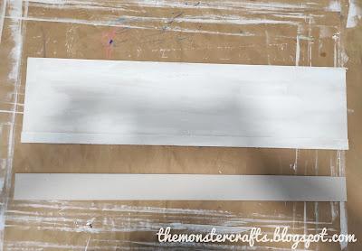 Binding cardboard pieces to build the wainscot