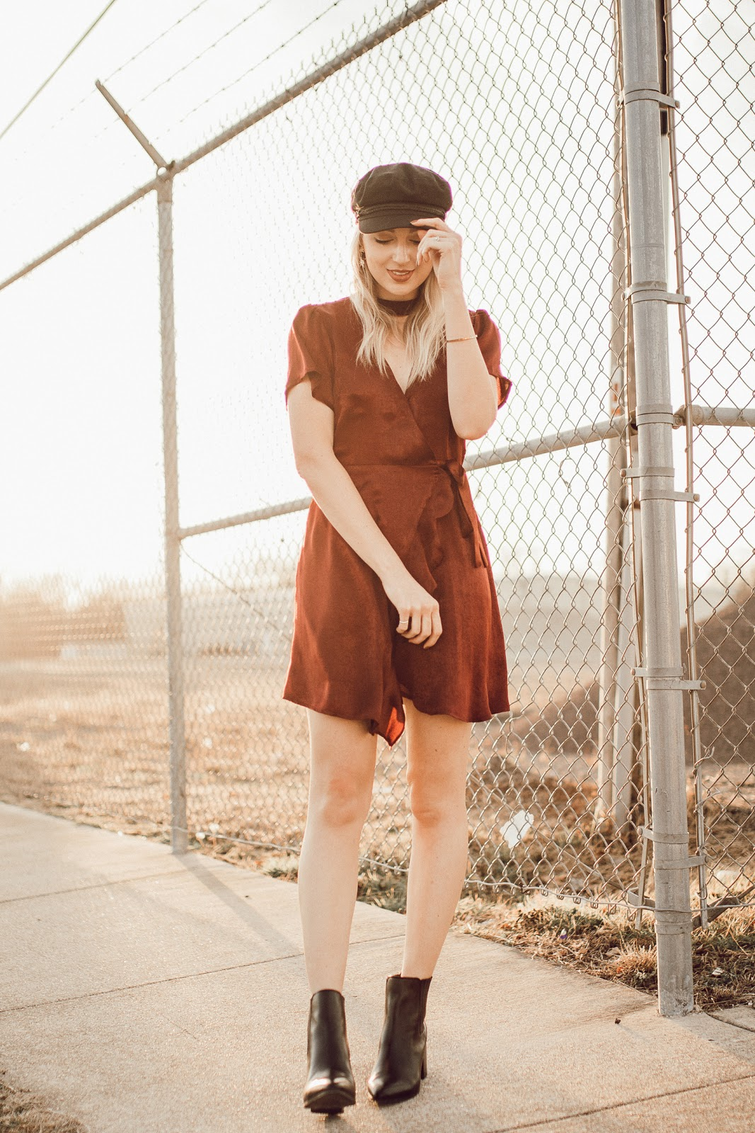 satin dress dressed down with ankle boots and a hat