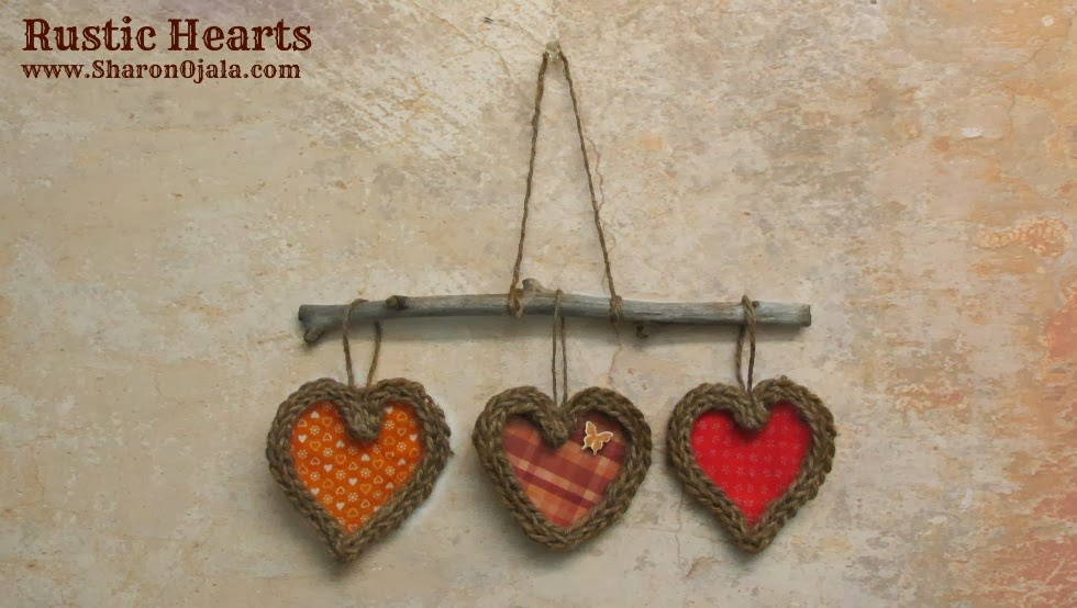 3 rustic twine hearts hanging from a twig